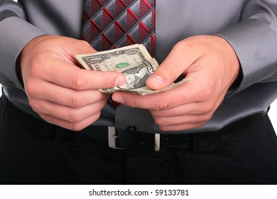 The businessman in a grey shirt and a tie has control over money.