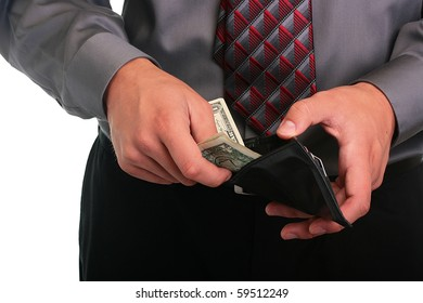 The businessman in a grey shirt and a tie hides money in a purse.