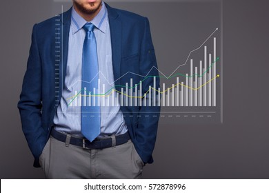 Businessman with growing chart, economy going up