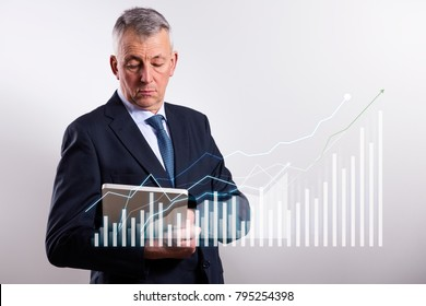 Businessman with growing chart, economy going up.