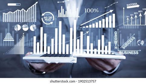 Businessman with a growth graphs. Business. Development. Success
