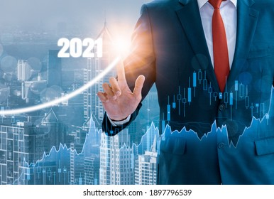 Businessman Growth success,using finger touch 2021,stock graph and chart background,concept growth development business investment,Stock market,strategy making market plan,stock market fluctuation