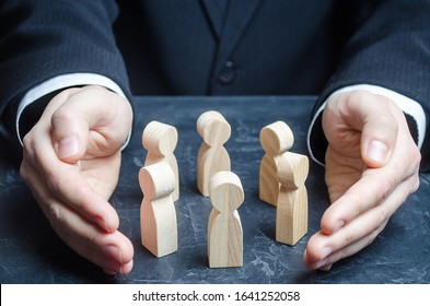 Businessman guards a circle of people with his hands. Team insurance. Preservation protection of company, ensuring safety of society. Legal services. Patronage, team building. Leader and leadership.