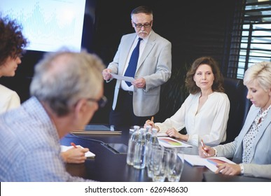 Businessman guiding in conference room