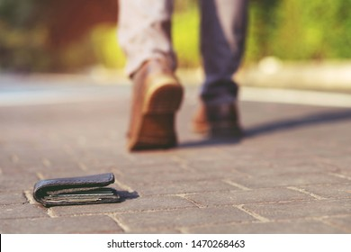 businessman had lost leather wallet with money on the street. Close-up of wallet lying on the sidewalk in during the trip to work. Leave space for writing messages.