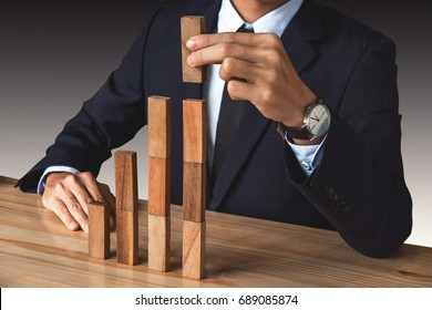 Businessman hand arranging stacking wooden blocks development as step stair, Business growth success process, Growth concept with wooden blocks, plan and strategy in business.