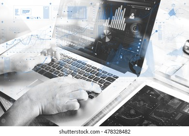 Businessman hand attending video conference with laptop and tablet computer at desk in office. virtual screen , black white