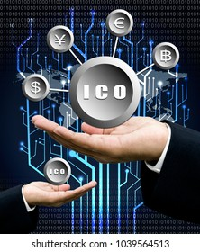 Businessman hand carry ICO symbol, Initial Coin Offering, icon on a virtual screen. Cryptocurrency, Bitcoin and ICO Digital Electronic Trade Market Stock Index concept.