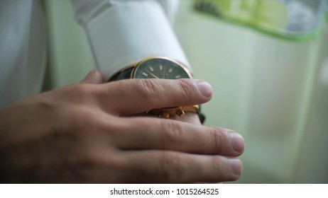 Businessman hand checking the time on wrist watch closeup. Clip. Businessman with clock. Expensive hours on the hand of a businessman