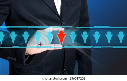 Businessman hand choosing people icon as human, resources concept