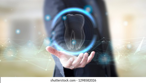 businessman hand with digital technology tooth