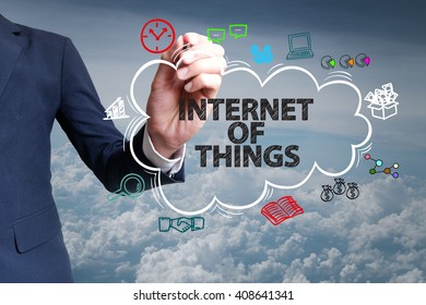 businessman hand draw cloud , icon cartoon with INTERNET OF THINGS  text