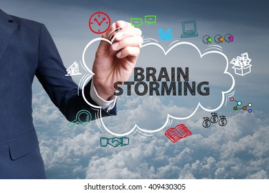 businessman hand draw cloud , icon cartoon with BRAIN STORMING  text