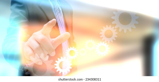 businessman hand drawing business graph and cog gear