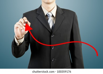 businessman hand drawing chart red arrow