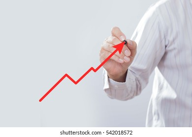Businessman hand drawing a chart show