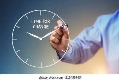 Businessman hand drawing a clock on whiteboard with time for change concept for planning, improvement and progress