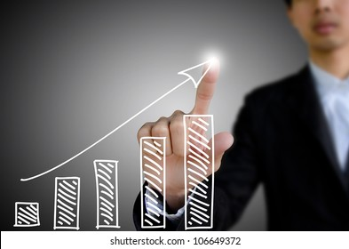 businessman hand drawing a graph