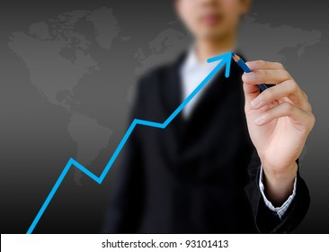 businessman hand drawing a graph.