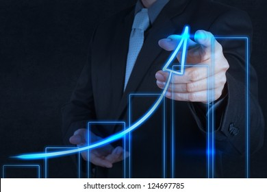 businessman hand drawing virtual chart business on touch screen computer