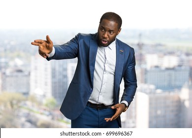 Businessman hand forefinger pointing with fingers. Afro american young manager with hand gesture pointing direction. The director gives instruction.