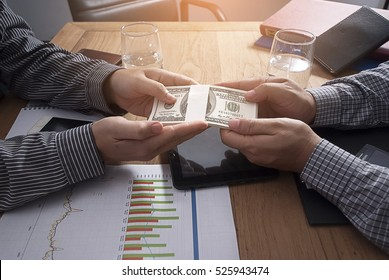 Businessman hand giving money - American dollars.