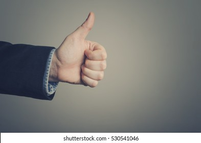 Businessman hand giving thumbs up
