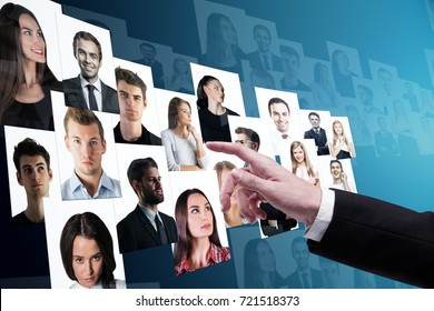 Businessman hand going through candidate picture gallery on blue background. Social media and recruiting concept