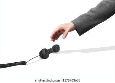 Businessman hand grabbing phone