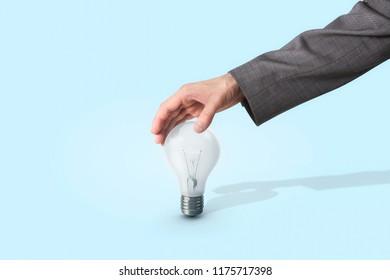 Businessman hand grapping light bulb