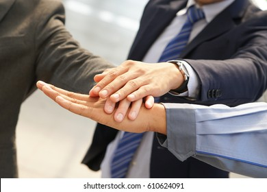 Businessman Hand group Teamwork Join Hands Partnership Third party, Business clasping hand Concept.