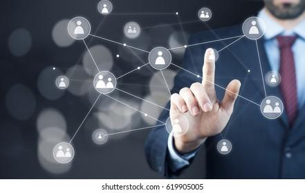 businessman hand  grupe in bokeh backgroud  on the screen