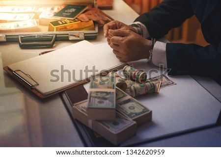 Businessman hand with handcuff