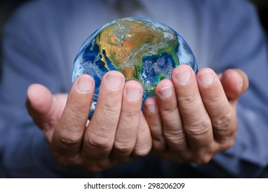 businessman hand hold the earth , politics or environmental conservation Earth image courtesy of Nasa