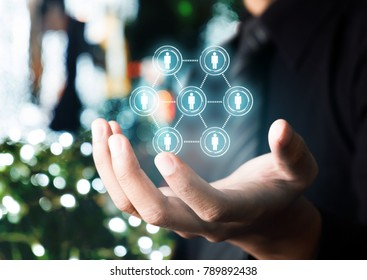 Businessman hand hold network concept with bokeh background