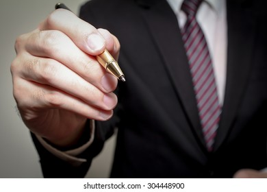 businessman hand hold pen prepare to writing