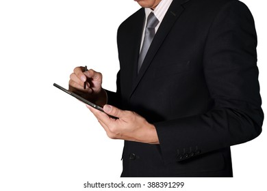 Businessman hand hold and use tablet as business, technology and communication concept.