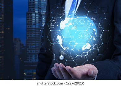 Businessman hand holding abstract hologram planet earth and social media chart background around it symbolizing international human resources business. HR networking.
