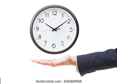 Businessman hand holding an alarm wall clock, time management concept