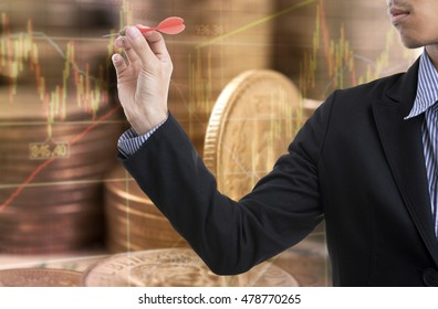 businessman hand holding arrow standing in front of a target. achieving a goal business finance concept