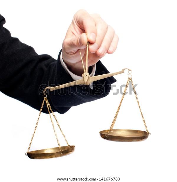 businessman hand holding a balance on white background