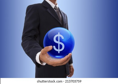 Businessman hand holding blue crystal ball with dollar sign icon.