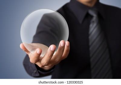 businessman Hand holding a Glass Ball