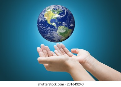 """Businessman hand holding globe with Earth in the background """"Elements of this image furnished by NASA""""."""
