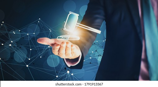 Businessman hand holding hammer icon,with futuristic line network, concept bid winner highest bidder in final lift,with public sale property auctioned business competition,e-auction and online bidding