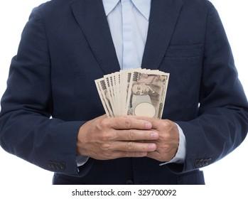 Businessman hand holding Japanese Yen