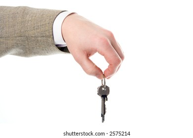 businessman hand holding the key to success