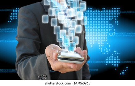 businessman hand holding mobile phone and virtual buttons