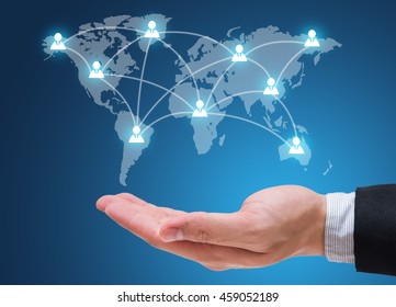 Businessman hand holding people social network isolated on blue background