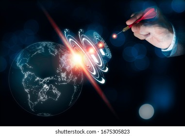 Businessman hand holding red arrow dart and shooting pass thru infographic to world.Business achieve target concept.